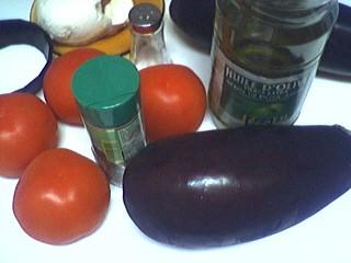Ingrédients pour la recette : Gratin d'aubergines et tomates à la mozzarelle
