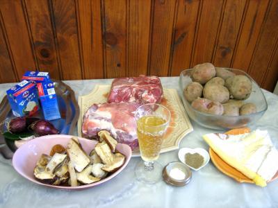 Ingrédients pour la recette : Sauté de porc au brie et aux cèpes
