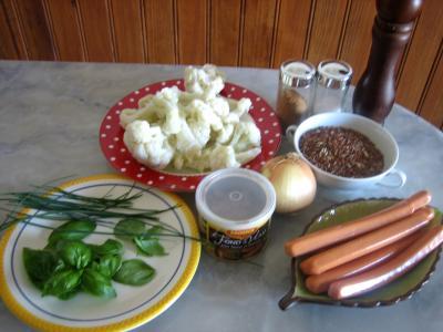 Ingrédients pour la recette : Chou-fleur et riz aux saucisses