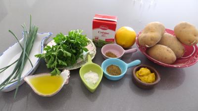 Ingrédients pour la recette : Quartiers de pommes de terre au cumin